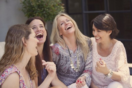 Happy female friends enjoying their friendship relationships.